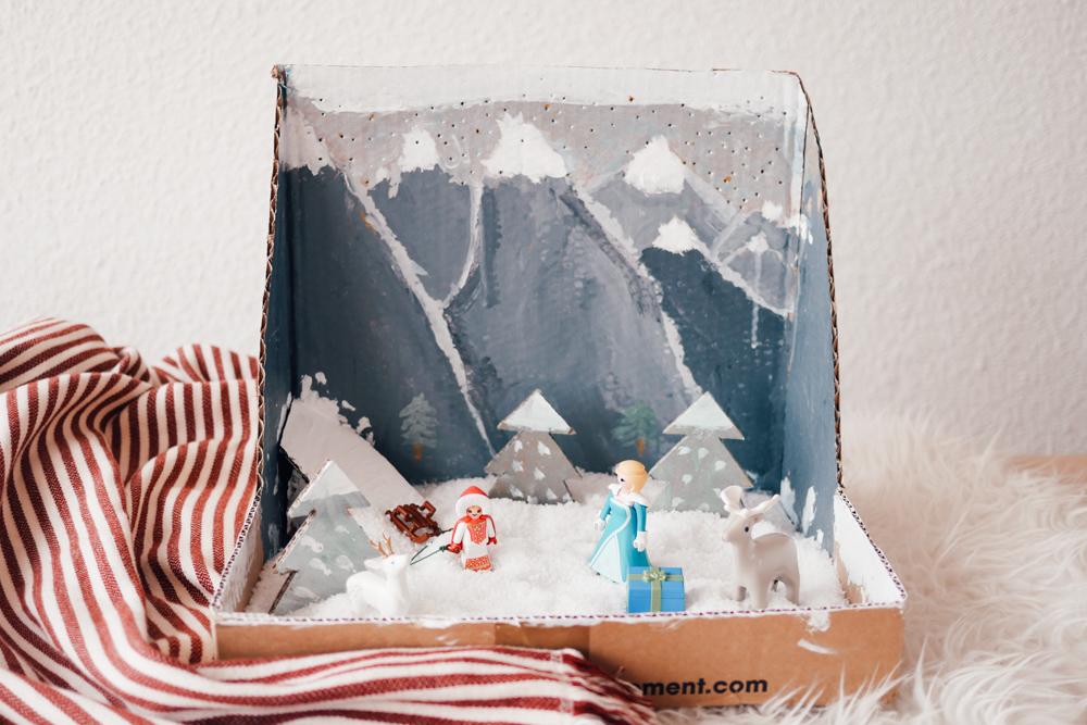 station de ski peinte en carton
